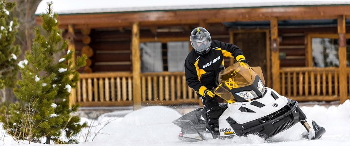 Man about to leave with his Ski-Doo Tundra snowmobile