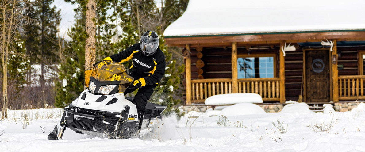 Man leaving with his Ski-Doo Tundra snowmobile