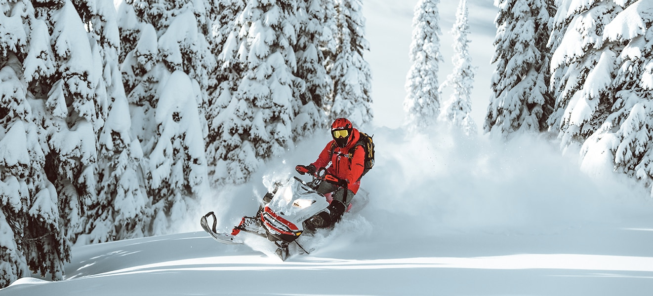 Man jumping in the air with his Ski-Doo snowmobile