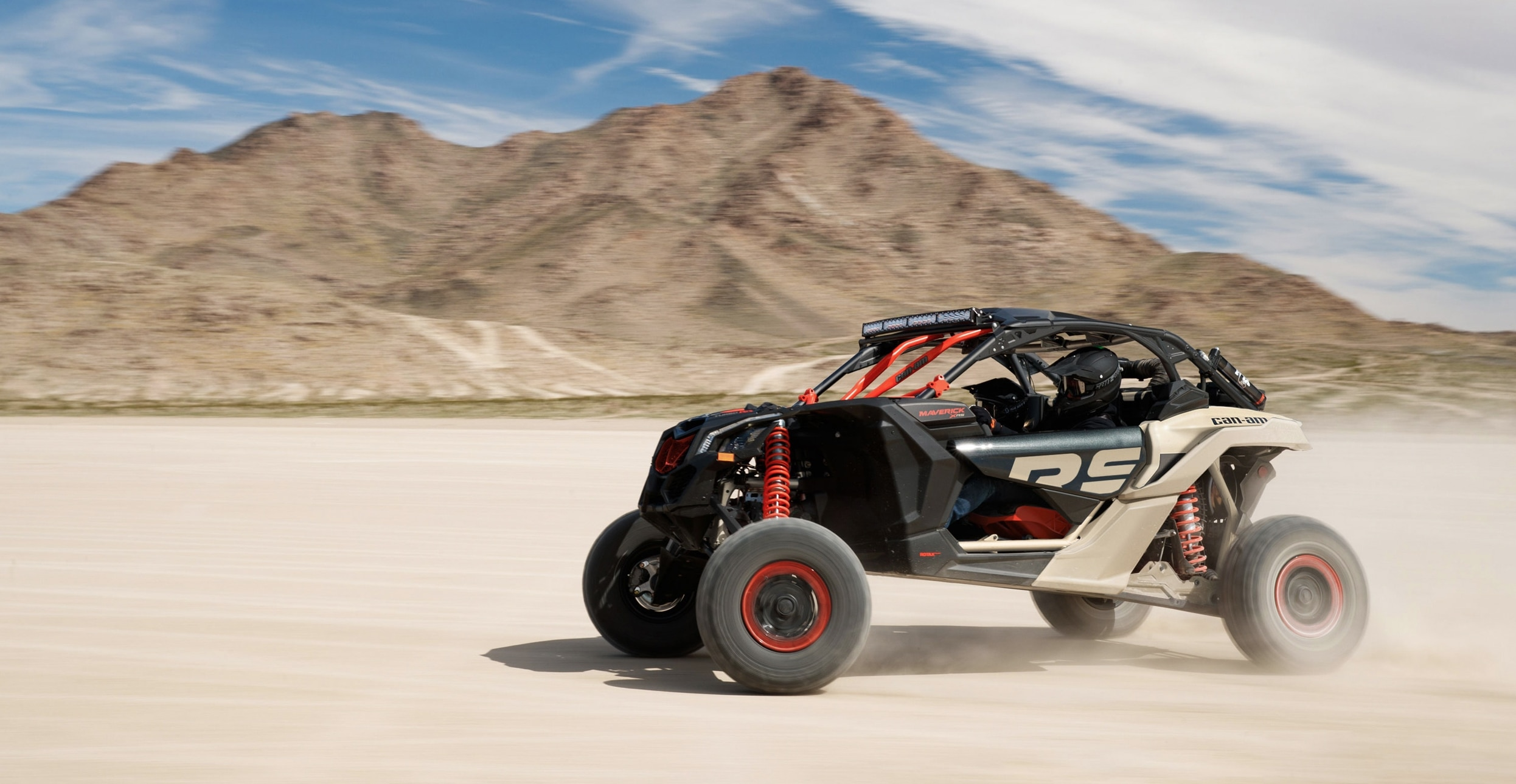 Man driving a Maverick X RS on the sand